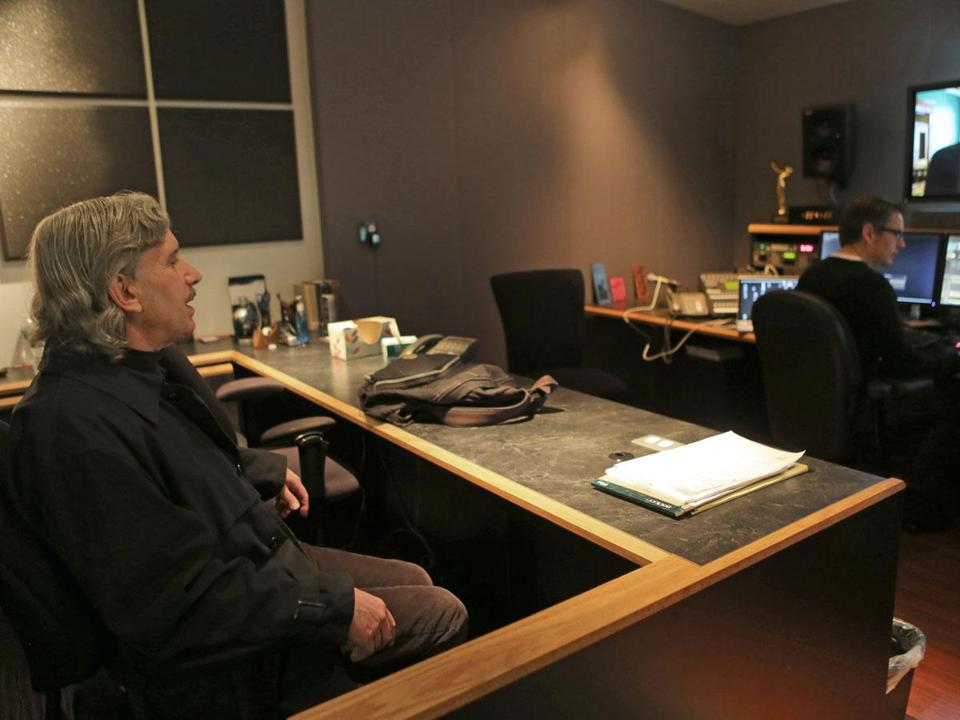 "Documentary filmmaker David Sutherland (left, with post-production editor Michael Amundson) in a Boston studio last week. Sutherland's ""Kind Hearted Woman'' airs on PBS's in two parts on April 1 and 2."
