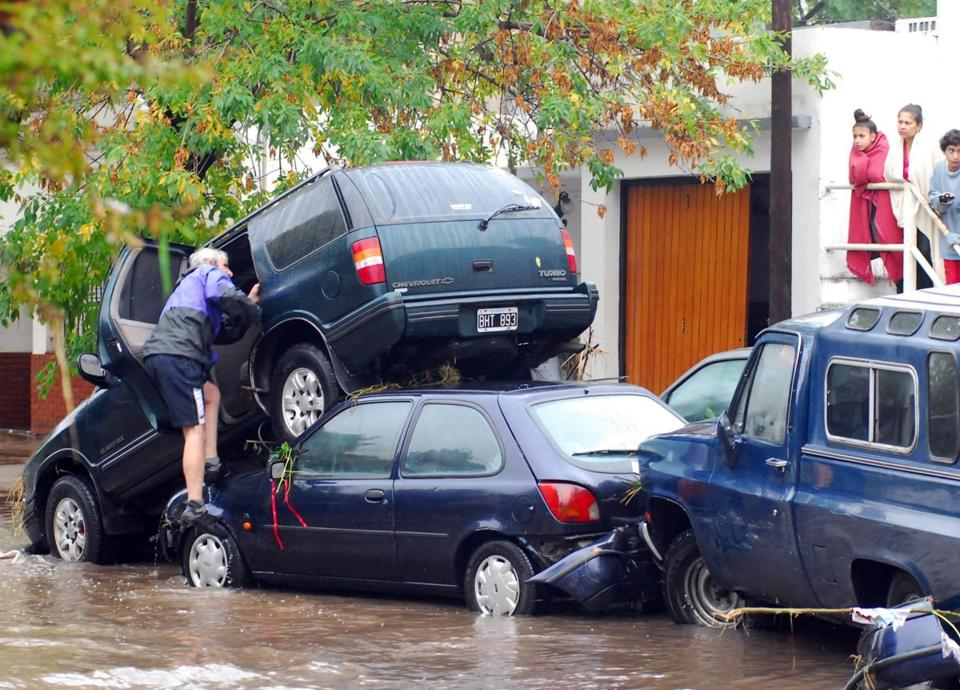 Flooding left automobiles in a heap in the Argentinian city of La Plata Wednesday, with more rain expected.