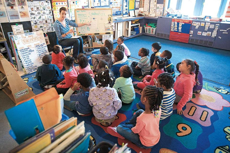 Teacher Kara Lysy worked with her K2 class at Dorchester's Lee Academy, which will be moving into its own building next year. Boston schools have seen an enrollment rise in the lower grades.