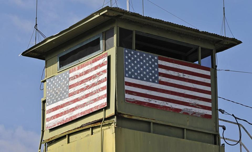 A US guard tower overlooks a gate at the Guantanamo Bay Naval Base in Cuba.