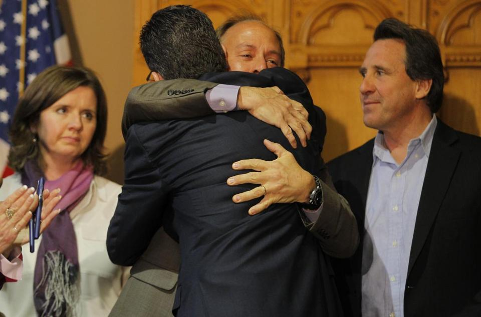 Governor Dannel P. Malloy of Connecticut, right, hugged Mark Barden, the father of a victim of the Sandy Hook school shootings, after signing new gun control legislation.