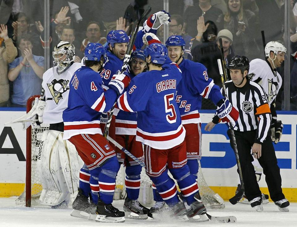 Ryane Clowe was congratulated by his new team after scoring.