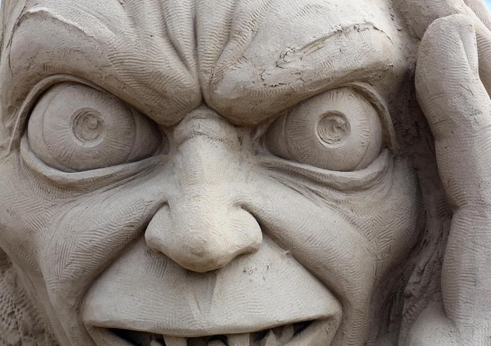 WESTON-SUPER-MARE, ENGLAND - MARCH 26: Detail of a sand sculpture of Gollum is seen as pieces are prepared as part of this year's Hollywood themed annual Weston-super-Mare Sand Sculpture festival on March 26, 2013 in Weston-Super-Mare, England. Due to open on Good Friday, currently twenty award winning sand sculptors from across the globe are working to create sand sculptures including Harry Potter, Marilyn Monroe and characters from the Star Wars films as part of the town's very own movie themed festival on the beach. (Photo by Matt Cardy/Getty Images)