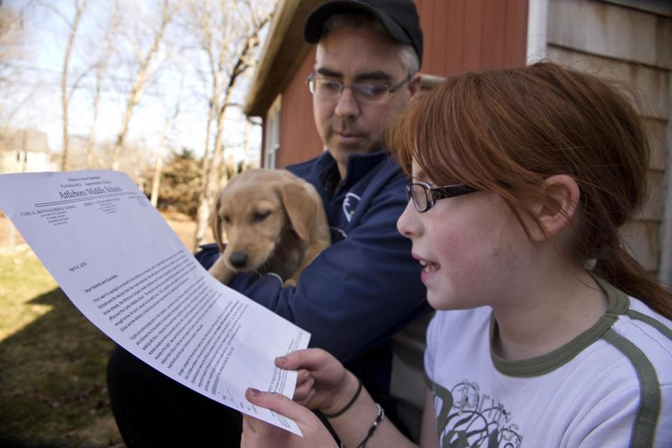 Victoria Greaves, with her father, John Greaves, read a letter sent home by Coelho Middle School's principal after she and two dozen other students were denied lunch on Tuesday.