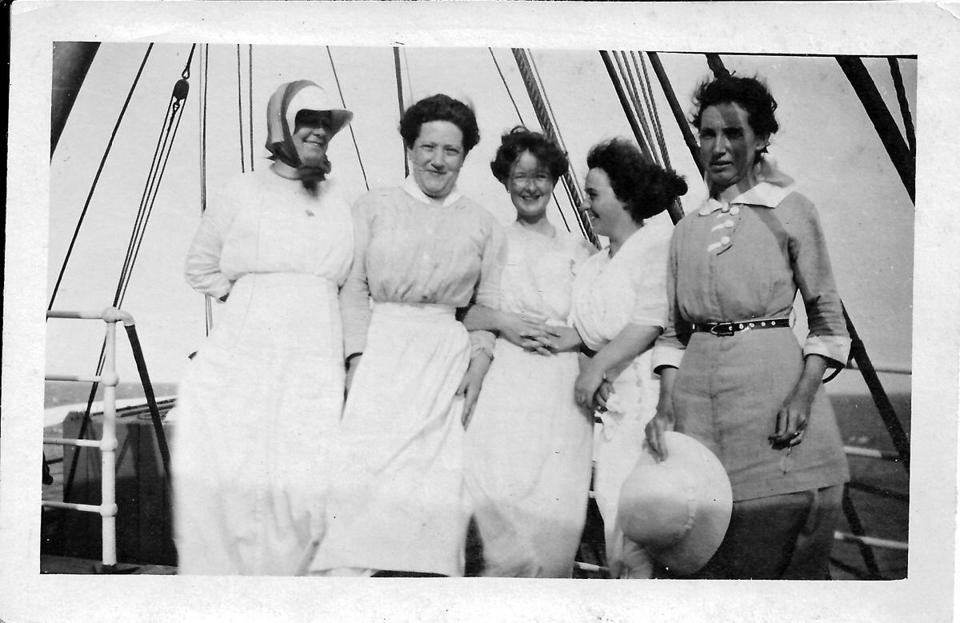 "An undated photo shows servants mingling with ""upstairs"" family members on a yacht owned by their employer, Hingham resident John J. Moore."