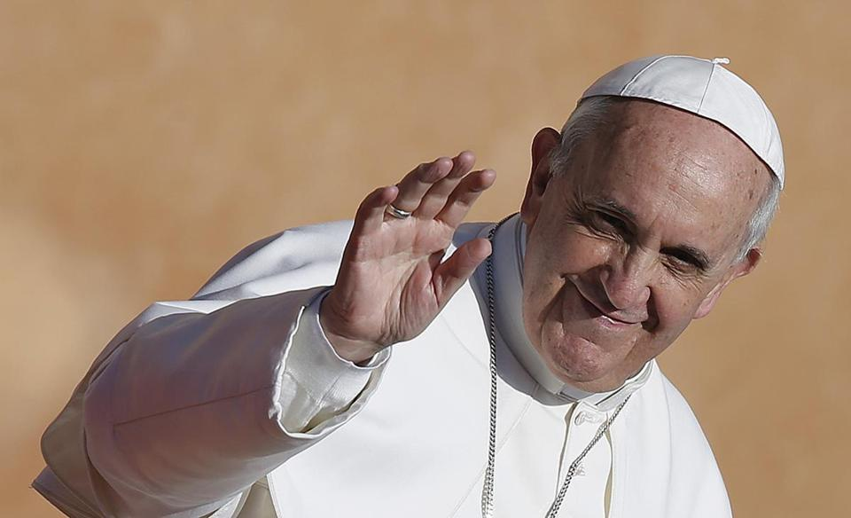 Pope Francis waved Sunday as he arrived a half-hour early.