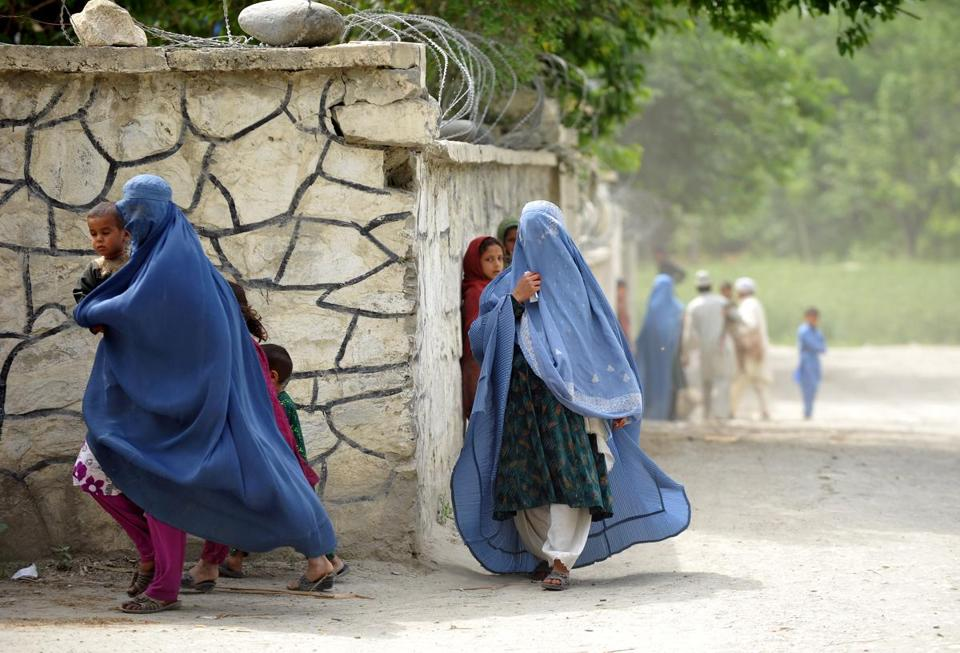 Afghan women ran for cover as American soldiers patrolled the Kush Kunar district in Nangarhar on Sunday.