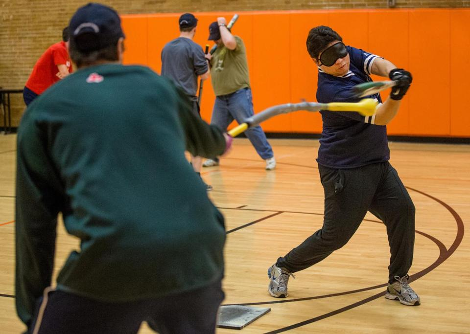 Joe Quintanilla of Chelsea practiced his swing during a Boston Renegades beep ball practice at Brighton High School.