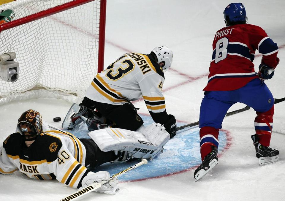 Canadien Brandon Prust scores on Bruins goalie Tuukka Rask as Bruins Matt Bartkowski tries to defend the net Saturday.
