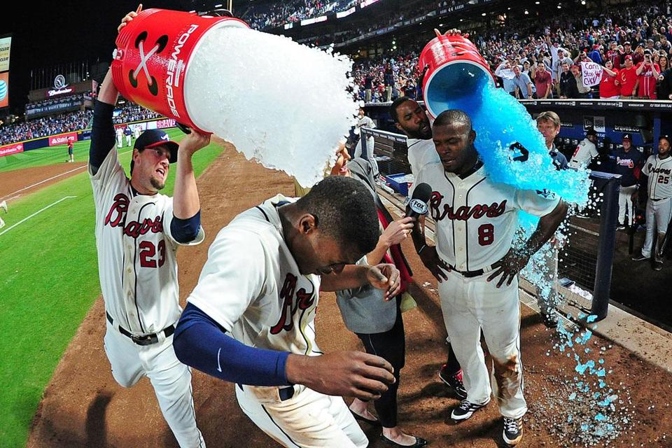 B. J. (left) and Justin Upton get the Gatorade treatment after ninth-inning heroics.