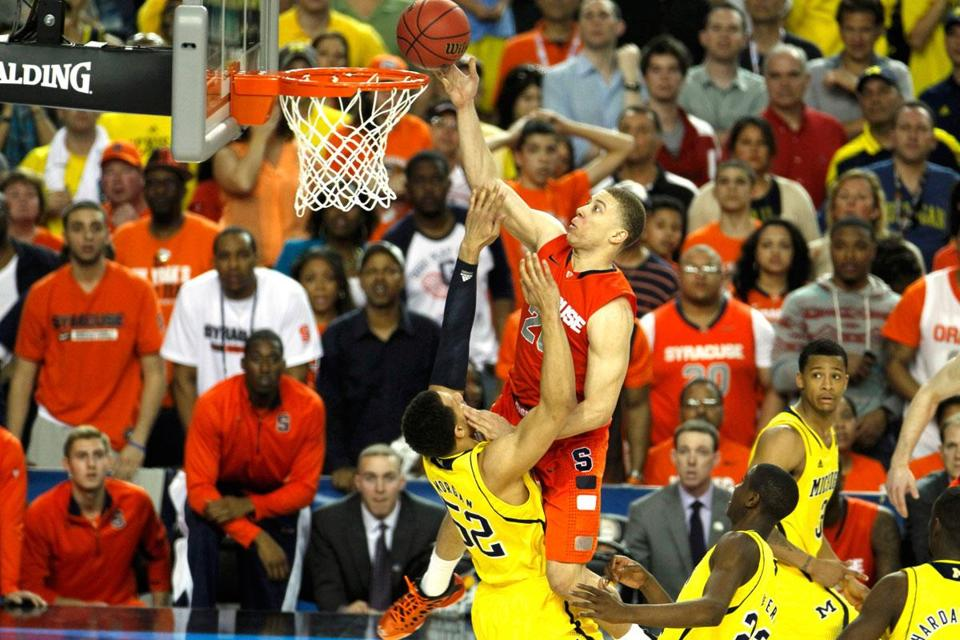 Michigan's Jordan Morgan (52) made the defensive play of the game, drawing a charge on Syracuse's Brandon Triche with 19 seconds left.