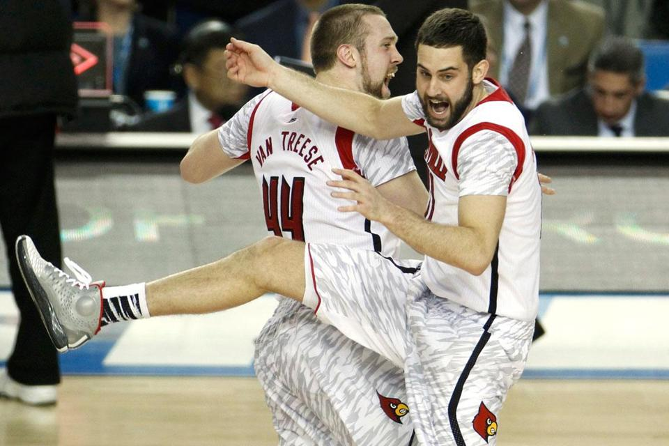 Louisville's Stephan Van Treese celebrates with Luke Hancock after the final buzzer.