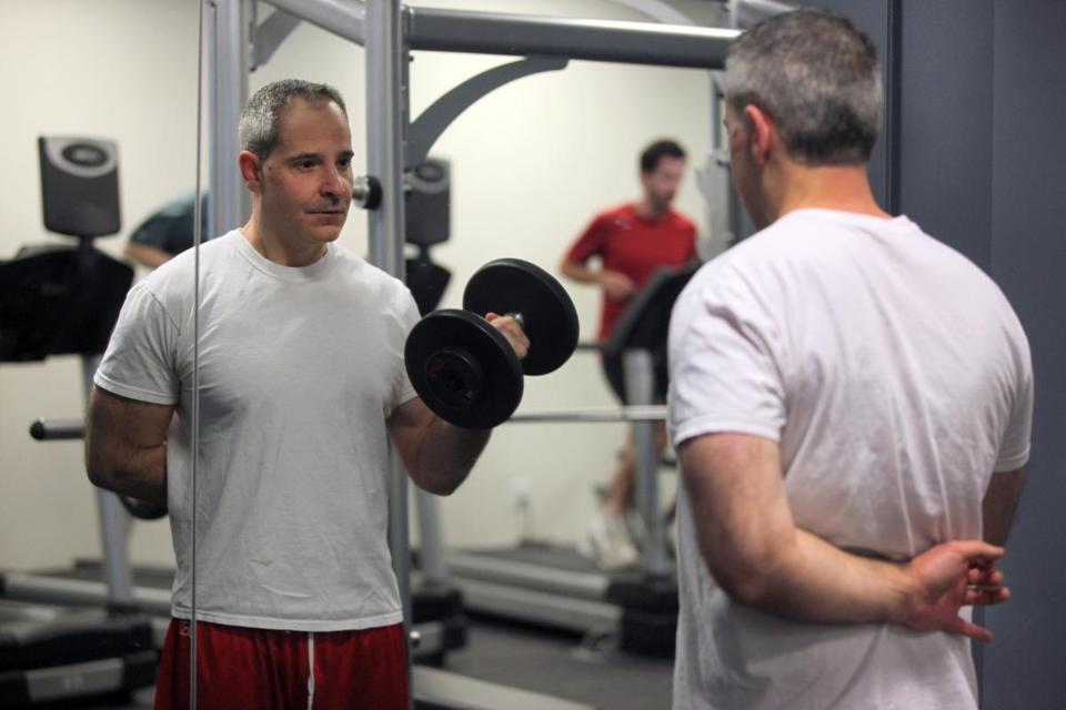 Stephen Falanga works out at the in-house gym at Alkermes, a pharmaceutical company in Waltham. Many employers offer fitness and wellness programs.
