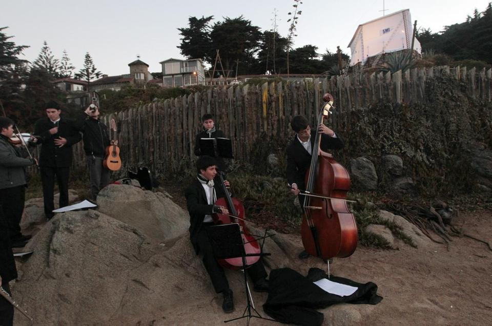 A band played during the exhumation of Nobel laureate Pablo Neruda's body in Isla Negra, Chile, on Monday.
