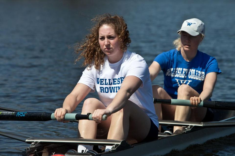 Becca Kimball (front) rows with Jennifer Lamy in a pair on Lake Waban on the Wellesley College campus.