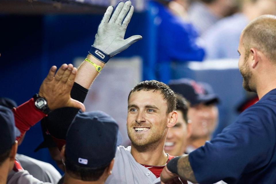 A dugout scene seen thrice Sunday in Toronto: the Red Sox' Will Middlebrooks celebrating a home run.