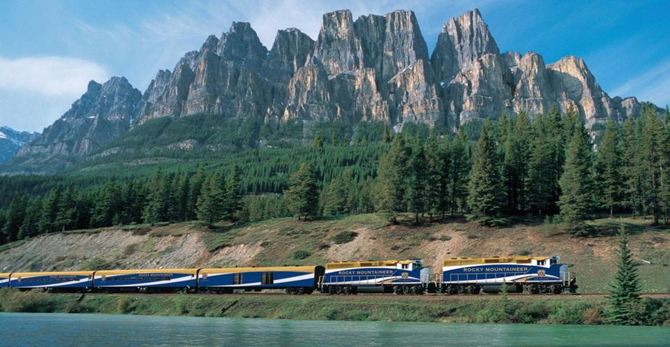 Rocky Mountaineer passing in front of Castle Mountain.