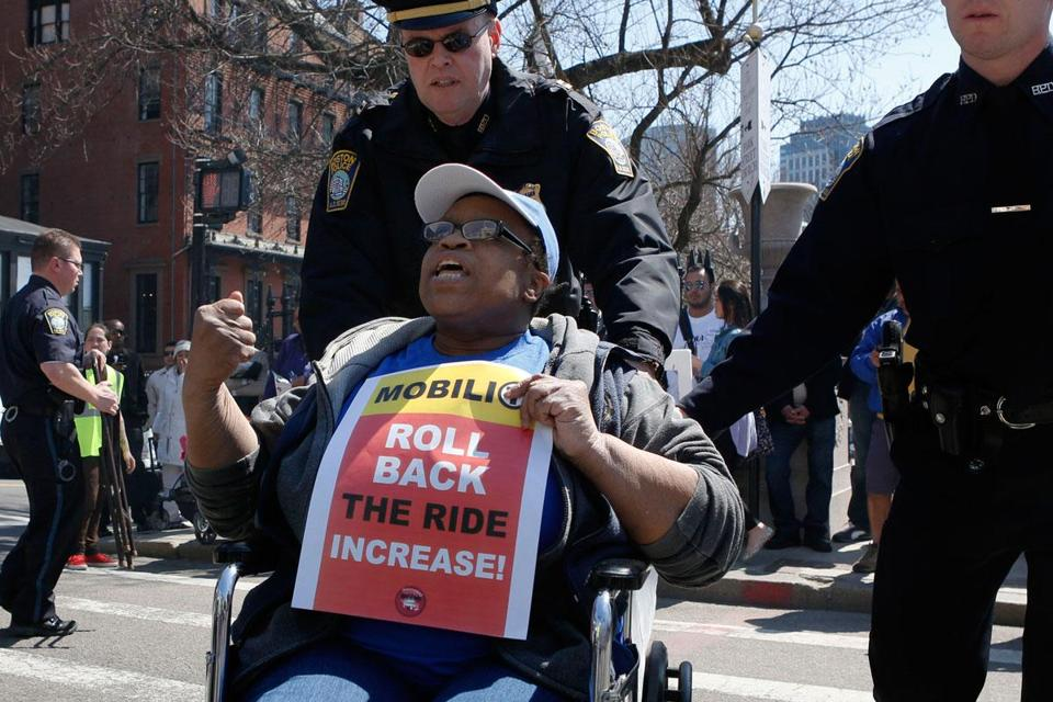 Denise Jackson of Lynn was among protesters who blocked the street in front of the State House Monday.
