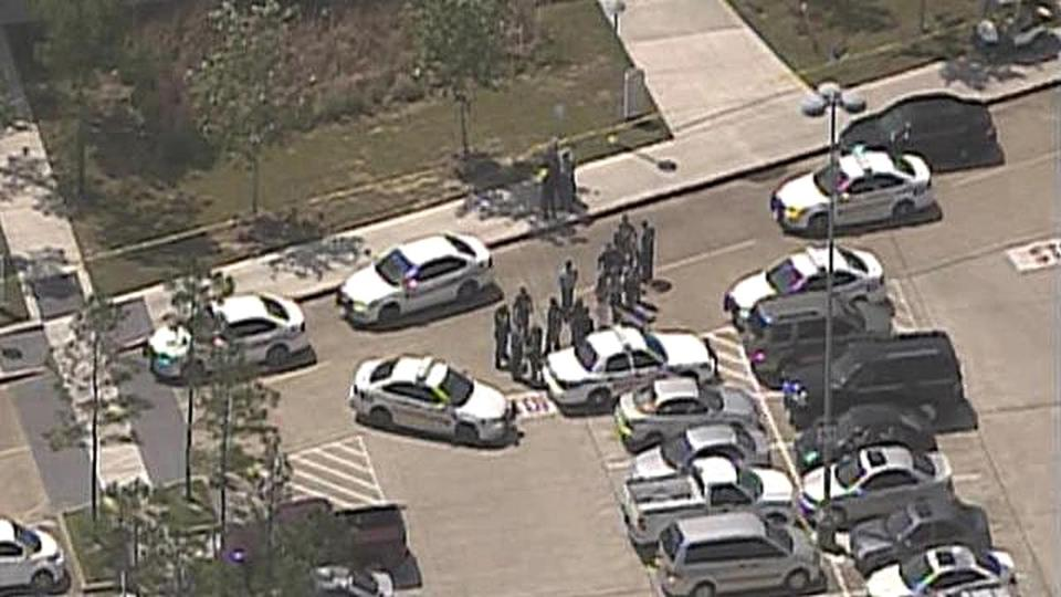 Law enforcement personnel gathered near the scene of a mass stabbing at the Cy-Fair campus of Lone Star College in northwest Houston.