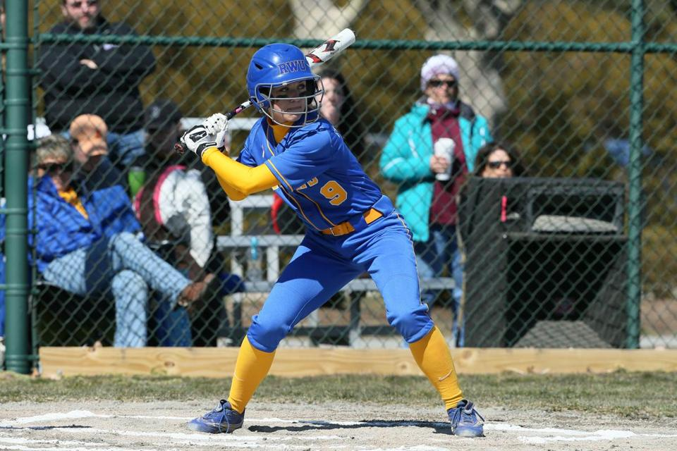 Lauren Tierney, a senior catcher, is home at bat and behind the plate on the Roger Williams University softball team.