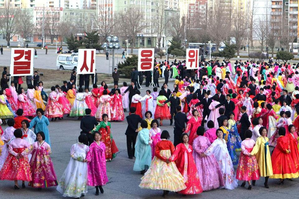 North Koreans danced on a street in Pyongyang as they honored the country's late leader Kim Jong Il.
