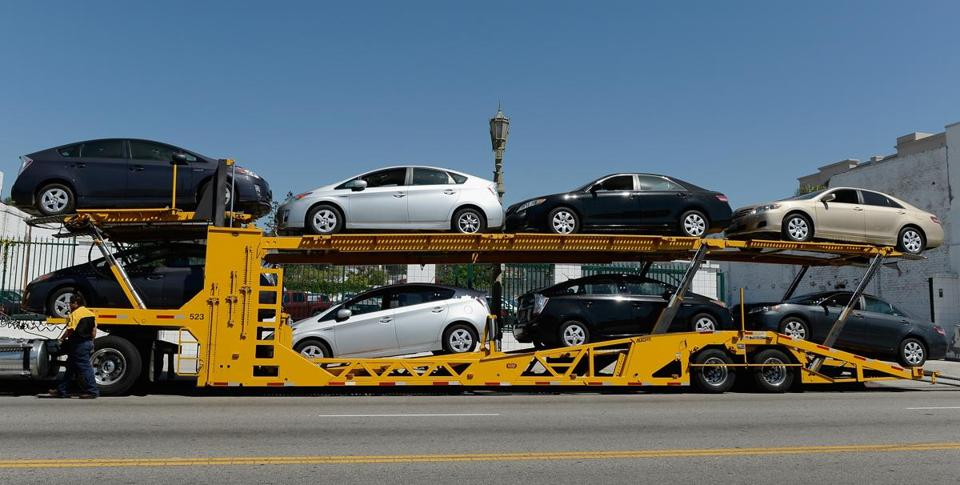 A vehicle transporter picked up cars at a Toyota dealership in Los Angeles on Thursday. Other automakers in the recall include Honda, Nissan, and General Motors.