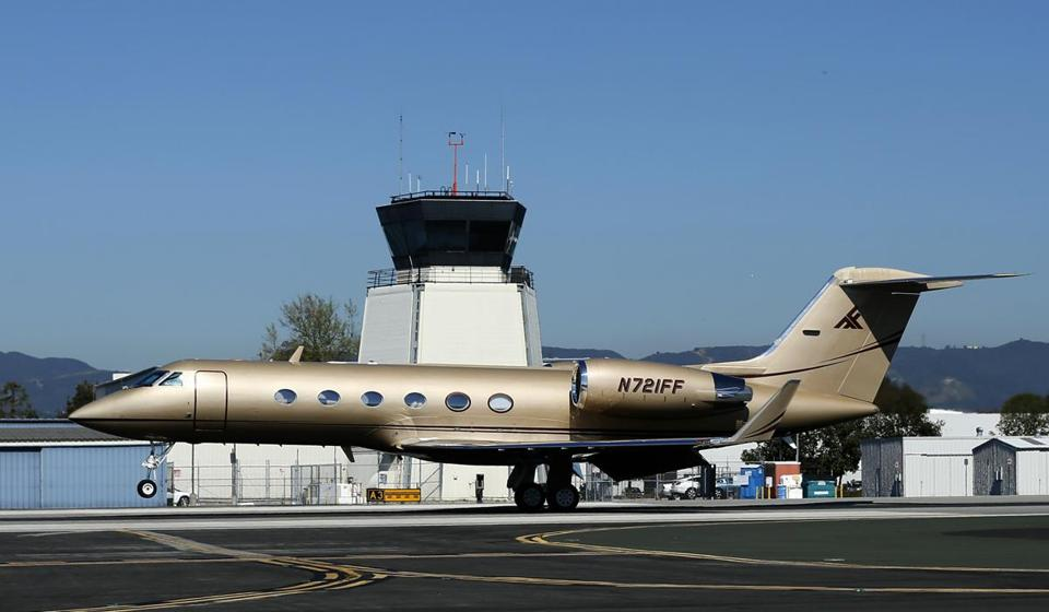 A Gulfstream Aerospace G-IV aircraft landed in front of the air traffic control tower at Santa Monica airport in California.