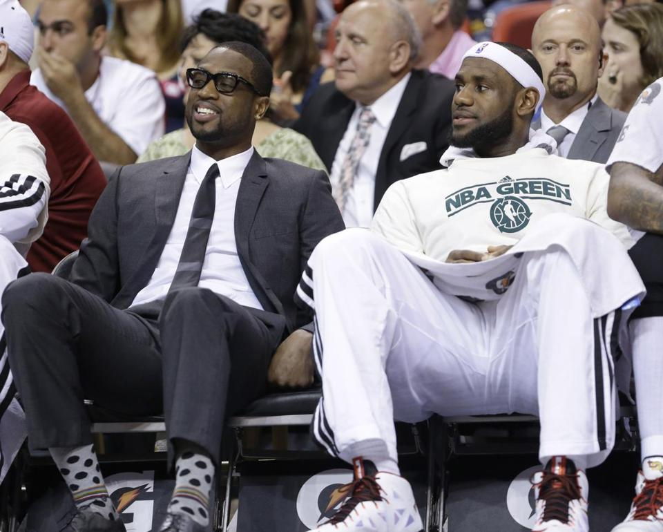 LeBron James (right hamstring) and Dwayne Wade (sprained ankle and bruised knee) looked like two guys sitting at a bus stop.