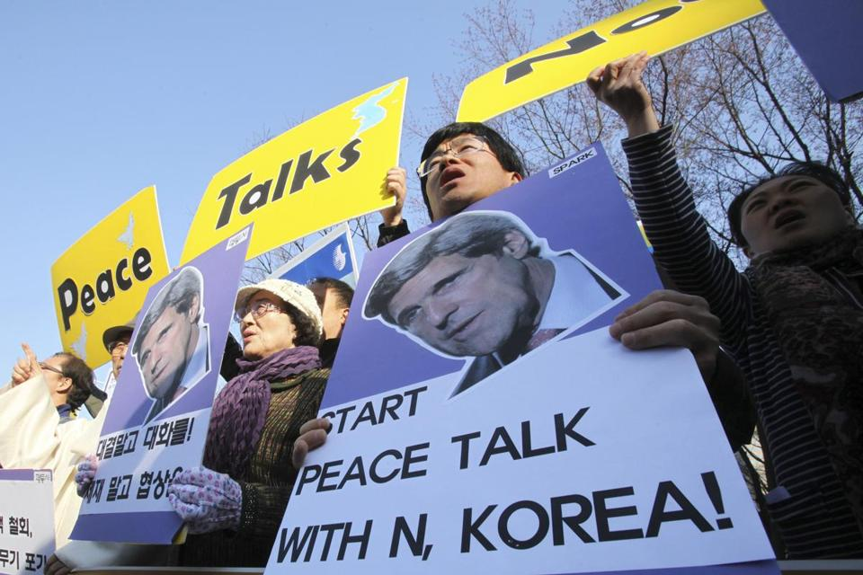 On Friday, protesters in South Korea call on US Secretary of State John Kerry to start peace talks with North Korea.