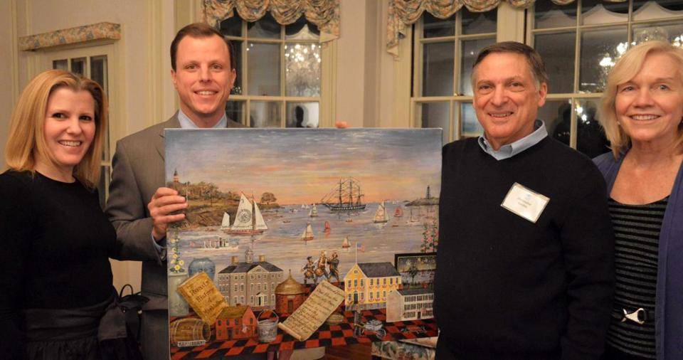 "ANNUAL FUND-RAISER: Hospice of the North Shore & Greater Boston's 2013 Auction and Regatta cochairwomen Meryl Thompson of Marblehead (far left) and Louise Sharp of Swampscott (far right) and this year's signature artist, Christopher Gurshin (second from right), and Paul Zekos, the event auctioneer, recently unveiled Gurshin's painting ""Marblehead Memories Forever."""