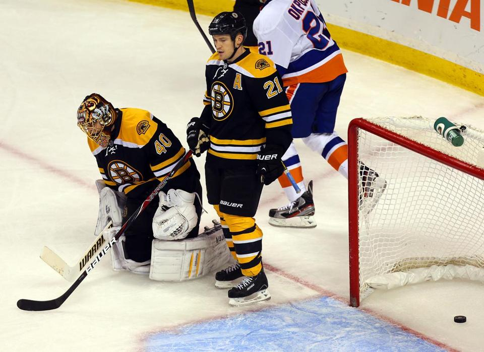 Bruins goalie Tuukka Rask and defenseman Andrew Ference are         feeling down after Josh Bailey's second-period goal, the         eventual winner.