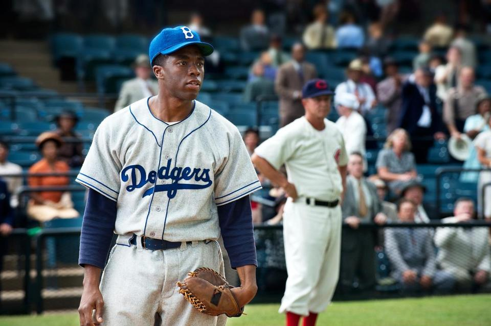 "Chadwick Boseman as Jackie Robinson in a scene from ""42."""