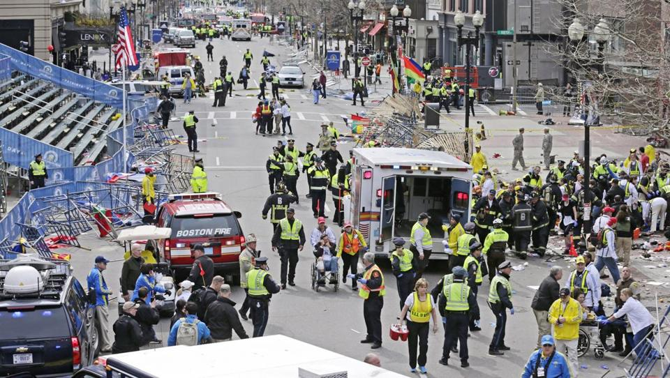 Medical workers swarmed the explosion site at the finish line of the 2013 Boston Marathon.