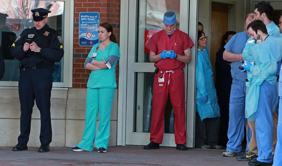 Boston Medical Center personnel wait for victims from the marathon bombings to arrive.