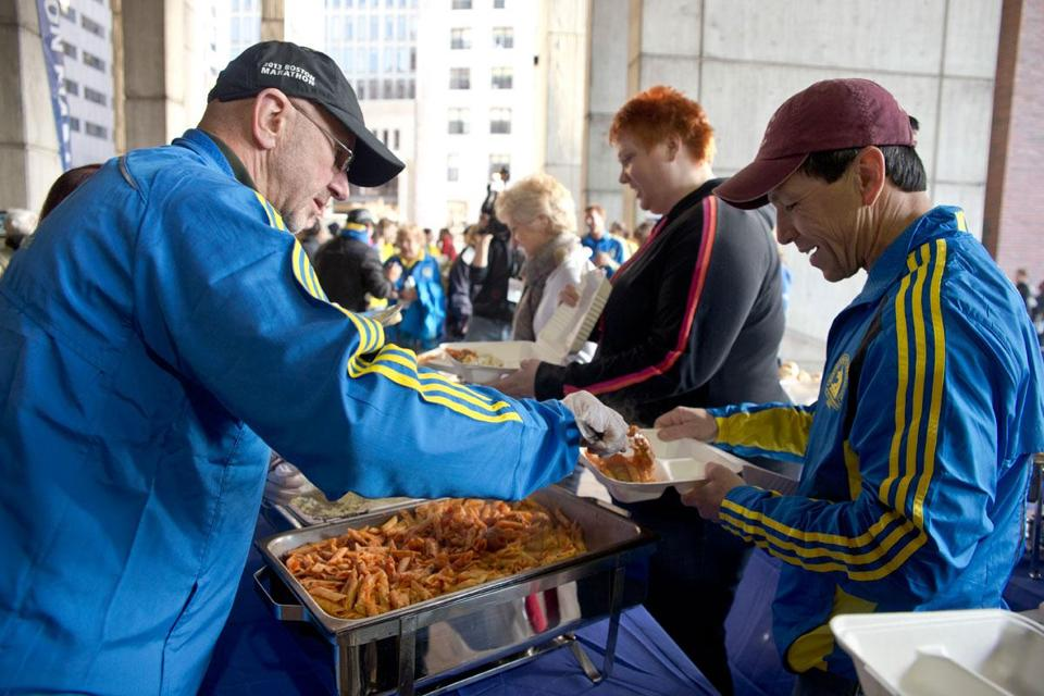 Greg Meyer, 1983 Boston Marathon champion, served pasta to Dave Lombardo of Eau Claire, Wis., at the prerace dinner at City Hall on Sunday. Organizers expected up to 15,000 people.