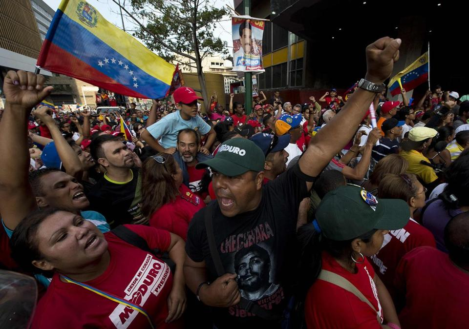 Supporters of Venezuela's acting president, Nicolas Maduro, cheered his apparent victory in Sunday's presidential vote.