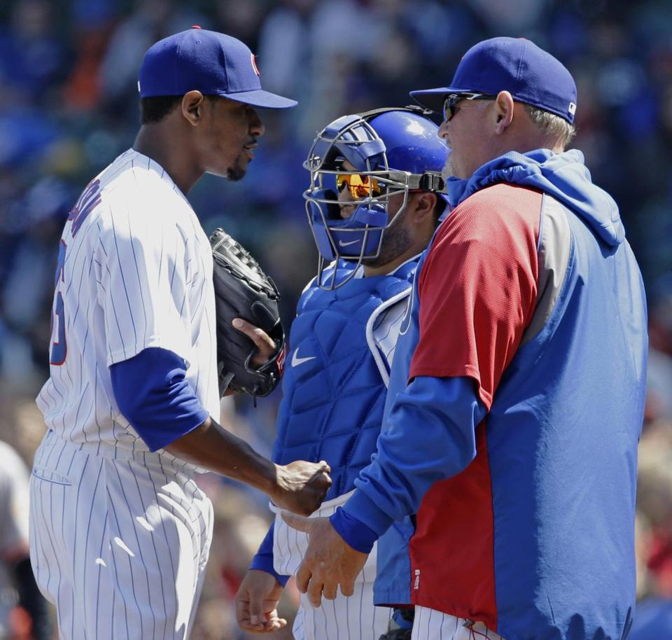 Edwin Jackson (left) was at a loss in a wild sixth inning in which the Cubs threw a record-tying five wild pitches.