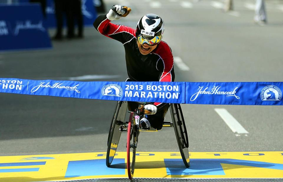 At the finish line of the Boston Marathon, men's wheelchair winner Hiroyuki Yamamoto hit the tape.
