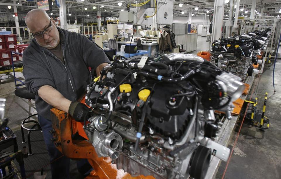 A worker on a Ford assembly line. Production of autos and auto parts surged 2.9 percent in March.
