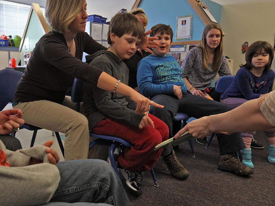 From left: teacher Clara Steece with student Sam, teacher Melissa Clark with Brian, and teacher Megan Anderson with Eliza during a session at the New England Center for Children in Southborough. The center is a leader in the treatment of autism.