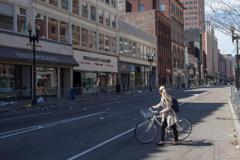 A bicyclist looked down Boylston Street in the Back Bay Tuesday, toward the finish line of the Boston Marathon and the site of the bombings a day earlier.