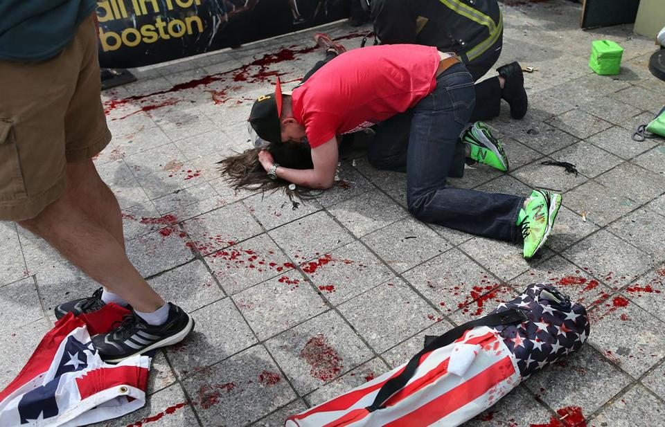 A man comforted a victim near the race finish line. Across the city, people met up to seek solace amid tragedy.