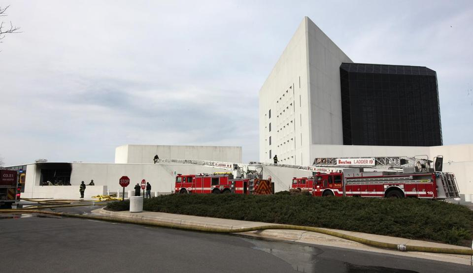 The fire at the JFK Presidential Library and Museum caused some damage to the exterior of the building (far left), blackening the area of what appeared to be a side entrance and shattering some windows. Inside, damage was caused mostly by smoke and water and not that much from the fire itself.