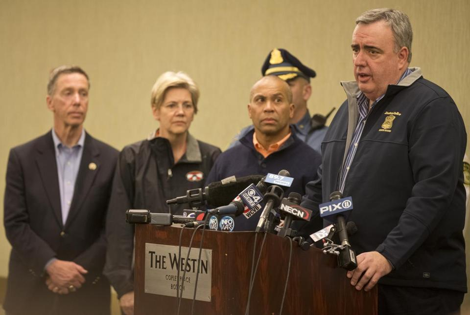 Boston Police Commissioner Edward F. Davis (right) spoke at an April 15 press conference about the bombings.