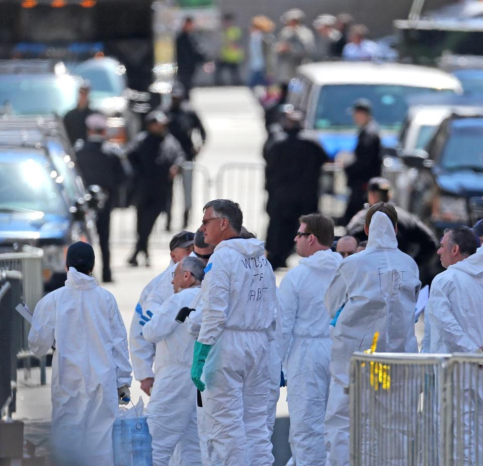 FBI and other officials continued to investigate the scene of the bombings on Boylston Street, scouring the streets and rooftops for clues.