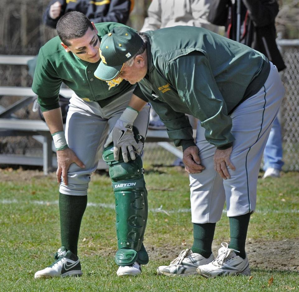 North Reading baseball coach Frank Carey (right) has reached 700 wins.