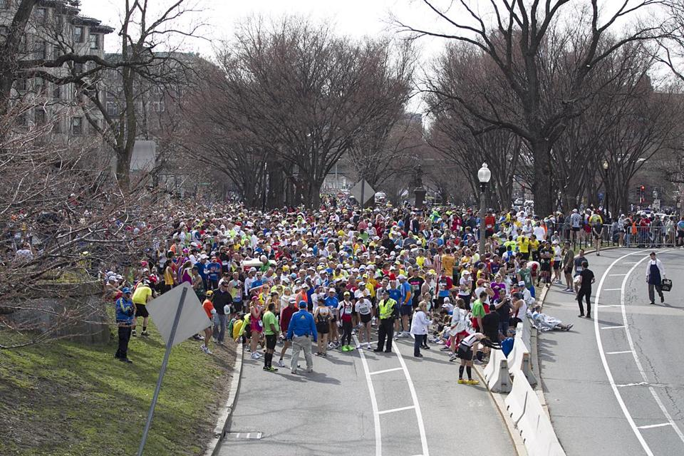 Marathon runners were stopped on Commonwealth Avenue before the Massachusetts Avenue overpass.