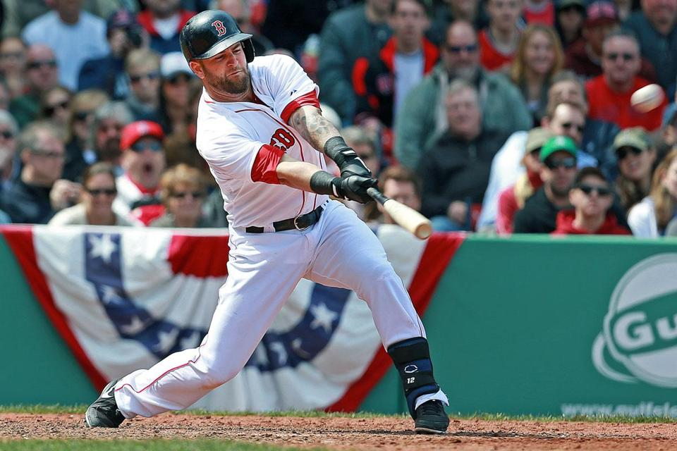Mike Napoli reaches out and drives a double off the Wall to bring home Dustin Pedroia with the winning run in the ninth inning Monday, the Sox' second walkoff win in three days.