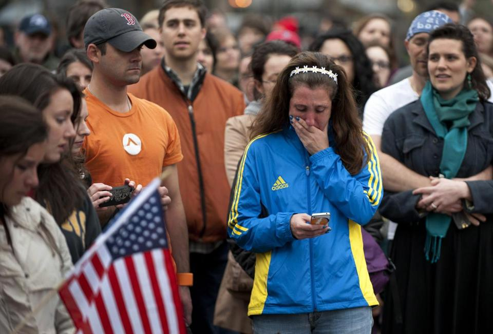 A woman wearing a Marathon  jacket cried as people gathered in the Boston Common for a vigil Tuesday.