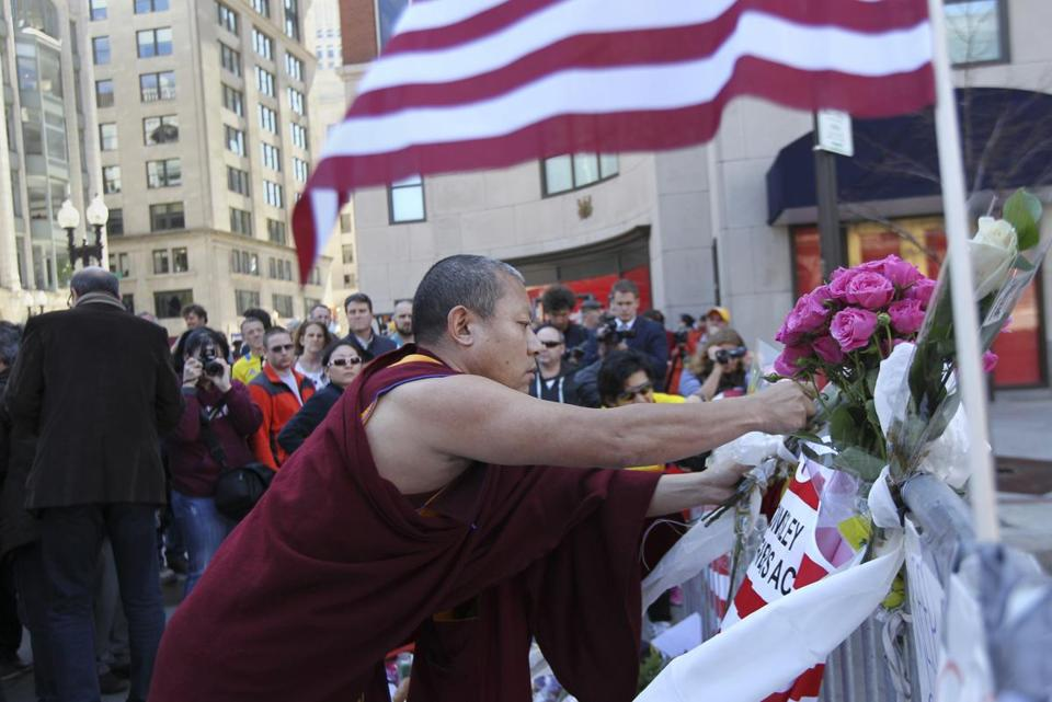 Geshe Tenley, a monk from the Kurukulla Center in Medford, visited the memorial at Boylston and Berkeley streets.